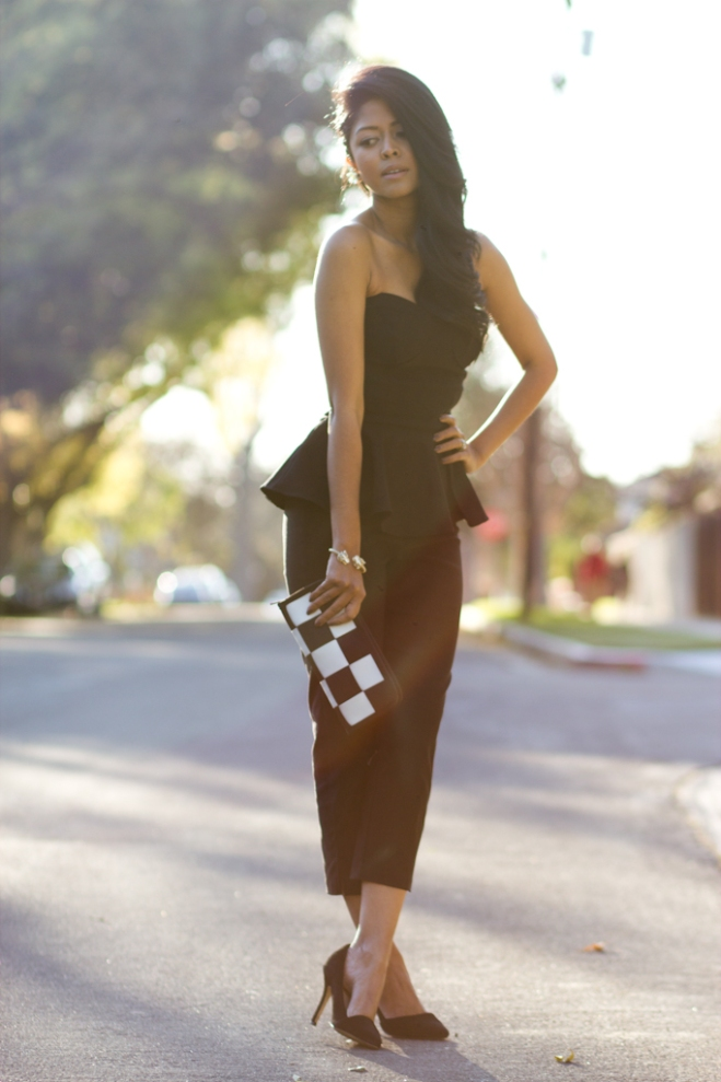 Walk in Wonderland wearing Peplum Jumpsuit from Lulus + Aldo Black heels + seatbelt clutch -3